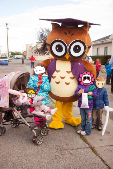 Round Brown and White Owl Mascot Costume with a Purple Graduation Cap